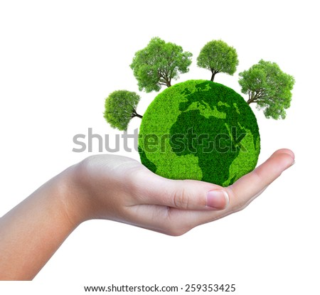 Hand holding green planet with trees isolated on white background - stock photo