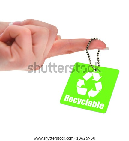 hand holding green tag with recyclable symbol - stock photo