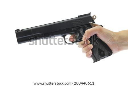 Hand holding gun isolated on white - stock photo