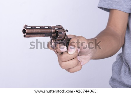 hand holding gun selective focus - stock photo