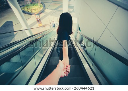 Hand Holding hand, Point of view. - stock photo