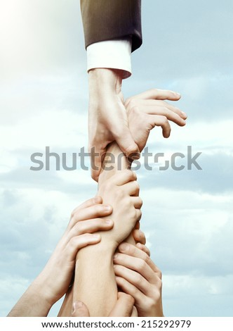 hand holding hands on a sky background - stock photo