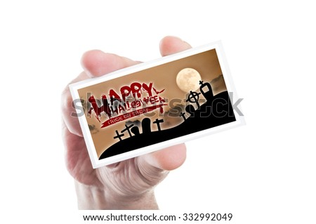 Hand holding happy Halloween and trick or treat card isolated on white background - stock photo