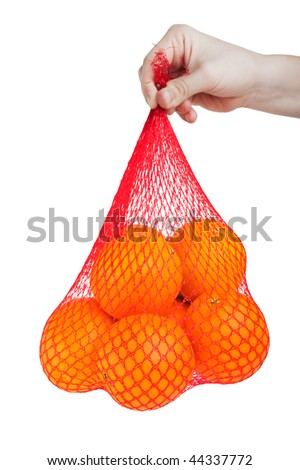 Hand holding healthy eating orange fruit food bag - stock photo