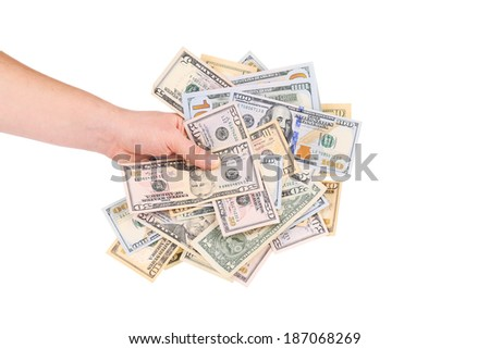 Hand holding heap of dollars. Isolated on a white background. - stock photo