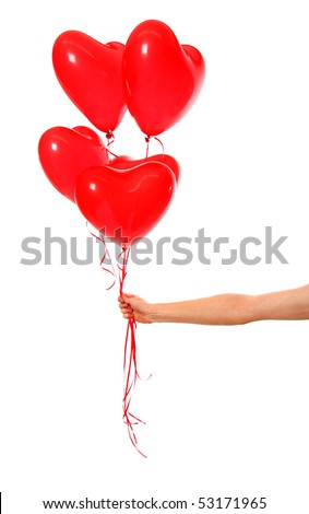 Hand holding heart ballons - stock photo