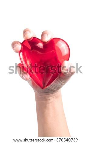 hand holding heart on white background - stock photo