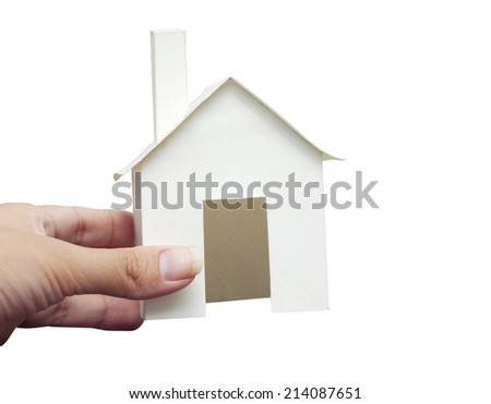 Hand holding house with write background