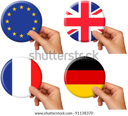 hand holding icons of flags of the European Union, United Kingdom, France and Germany. Includes clipping path