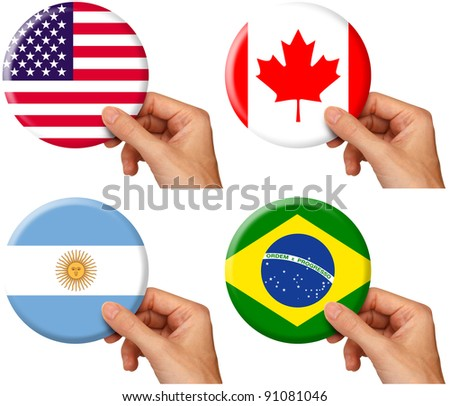 hand holding icons of flags of usa, canada, argentina and brazil - stock photo