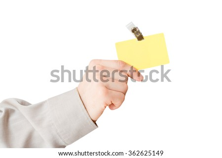 Hand holding ID - stock photo
