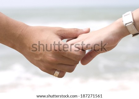 Hand Holding in Sea Background