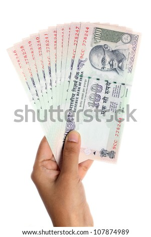 Hand holding Indian currency notes - stock photo