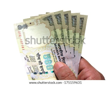 Hand holding Indian currency Rs 500 notes - stock photo