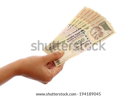 Hand holding Indian five hundred rupee notes against white background