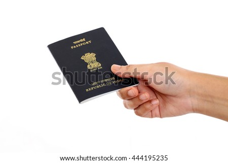 Hand holding Indian passport against white background