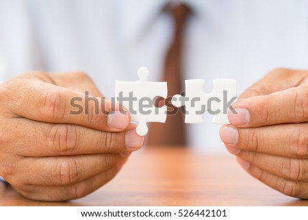hand holding jigsaw connection.