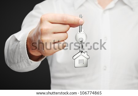 Hand holding key, business concept - stock photo