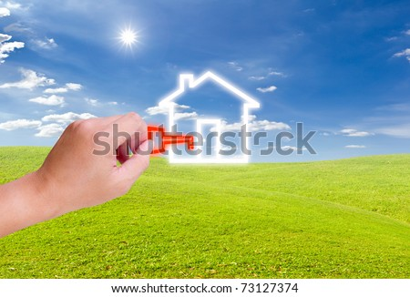 hand holding key for house icon - stock photo
