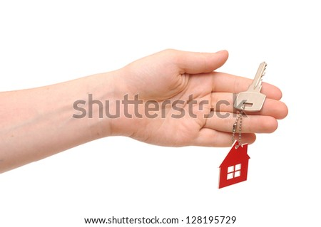 Hand holding key with a key-chain in the shape of the house on the white background - stock photo
