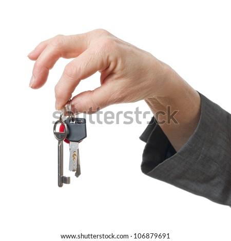 hand holding keys on white background - stock photo