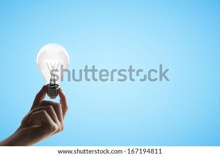 hand holding lamp,  idea concept - stock photo