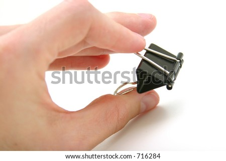 Hand holding Large Paper clip - stock photo