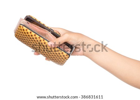 Hand holding leather bag with cash isolated on white background