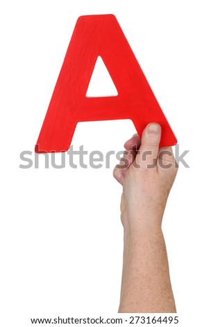 Hand holding letter A from alphabet isolated on a white background - stock photo