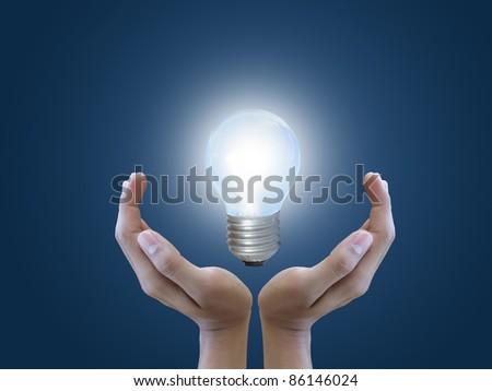 Hand holding light bulb - stock photo