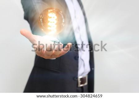Hand holding light bulb,idea concept  - stock photo