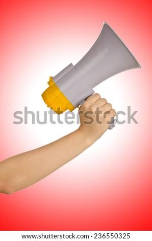 Hand holding loudspeaker on white - stock photo
