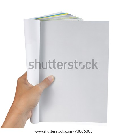 hand holding magazine. ready for your new design - stock photo