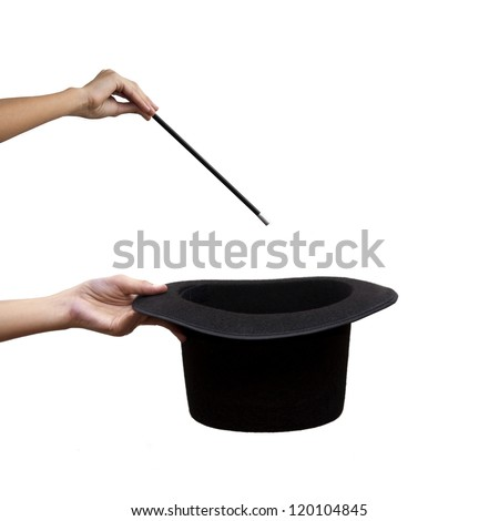 hand holding magic wand and hat - stock photo