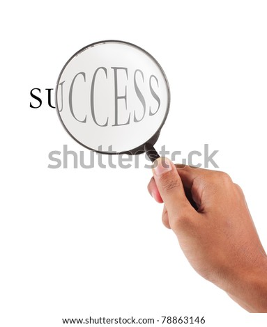 hand holding magnifier glass with success text - stock photo