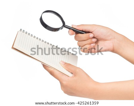 Hand holding magnifying glass isolated on white background - stock photo