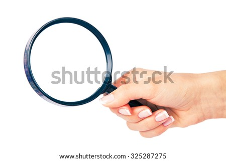 Hand holding magnifying glass on white backckground - stock photo