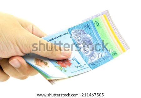 Hand holding Malaysia Ringgit Currency Bank Notes