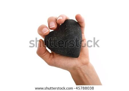 Hand holding massage stone isolated on white - stock photo