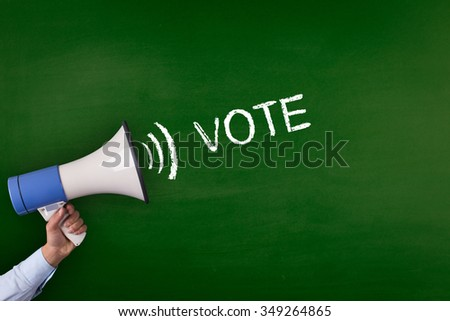 Hand Holding Megaphone with VOTE Announcement - stock photo