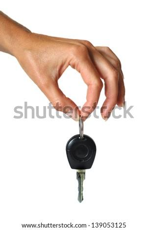 hand holding metallic key. isolated - stock photo