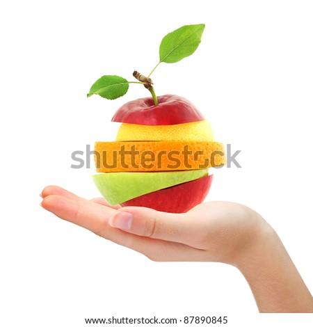 Hand holding mixed fruit - stock photo