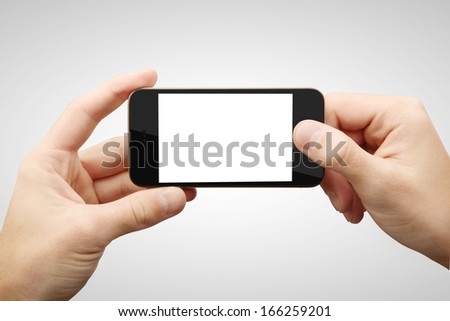 hand holding mobile phone, close up - stock photo