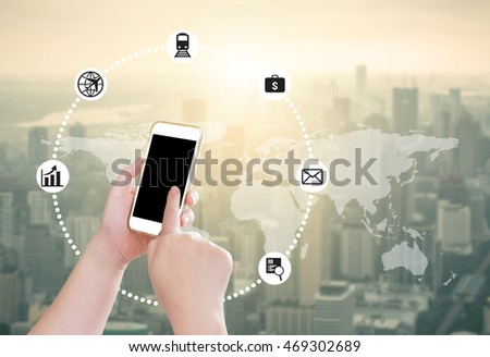 Hand holding mobile phone with blur cityscape background use for digital marketing concept