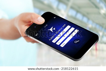 hand holding mobile phone with flights research application. focus on mobile phone - stock photo