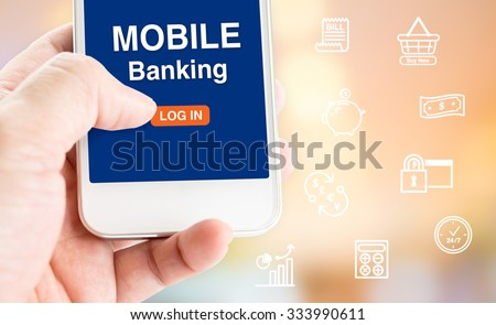 Hand holding mobile phone with MOBILE Banking word with related icon on blur background,Digital Marketing concept - stock photo