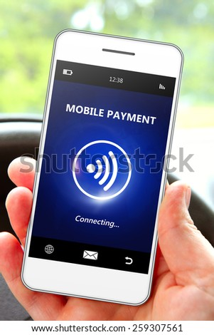 hand holding mobile phone with mobile payment. focus on phone - stock photo