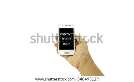 Hand holding mobile phone with written ??CONTACT PHONE BOOK?? on black background against white background. Communication concept. Selective focus and shallow of Depth of Field. - stock photo
