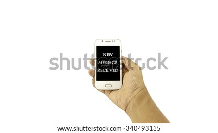 Hand holding mobile phone with written ??NEW MESSAGE RECEIVED?? on black background against white background. Communication concept. Selective focus and shallow of Depth of Field.