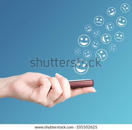 Hand holding modern mobile phone and smiles flaying away. Social media concept